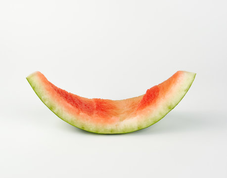 stub of red ripe round watermelon on a white background