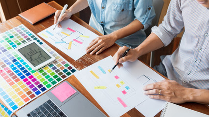 business technology concept, creative team designer choosing samples with UI/UX developing on...