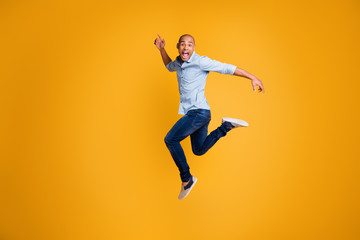 Full body photo of funky man feel content careless isolated over yellow background Wall mural