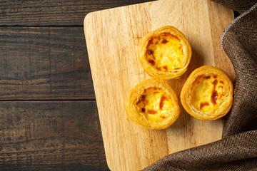 Egg tart on wooden background.