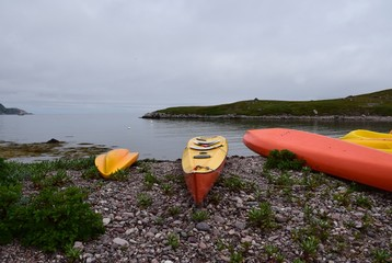 kayaks on the shoreline with view towards the ocean at Ile-aux-Marins Saint Pierre et Miquelon, France