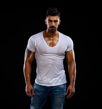 Handsome Male Fitness Model Wearing Jeans and White T-Shirts