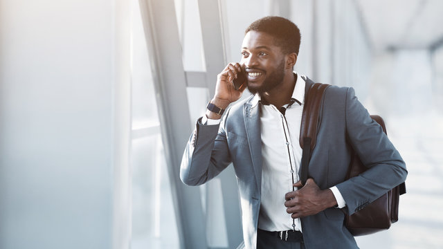 Afro Businessman Having Business Talk On Phone In Airport