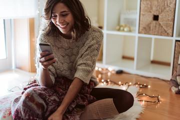 Woman texting in a smartphone - Christmas Season Wall mural