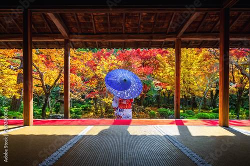 Wall mural Asian woman wearing japanese traditional kimono in autumn at Enkoji temple, Kyoto, Japan.