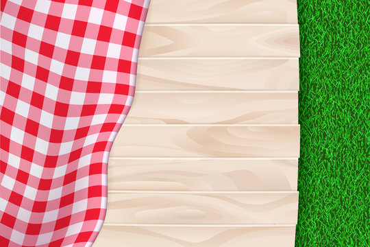 Picnic poster, banner background. Vector illustration of red plaid tablecloth on wooden table and green grass backdrop.