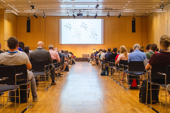Audience watching and listening to a scientific presentation in an European conference