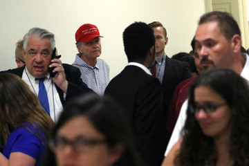 Man waits in line to attend former Special Counsel Robert Mueller testimony before House Intelligence Committee hearing on the Mueller Report on Capitol Hill in Washington