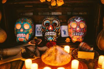 dia de los muertos decorations, painted skulls and candles