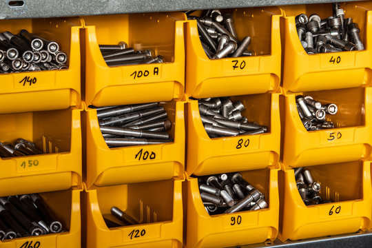 stainless steel screw in a yellow box