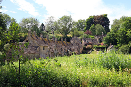 A Row Of Old English Stone Weavers Cottages Situated In The Cotswold Village Of Bibury. Gloucestershire. UK