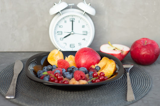 Times to Healthcare or Diet Food advisor show clock for timing care your health with healthy food and concept. Concept for healthy eating and nutrition. intermittent fasting diet