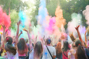 Holi festival of color. Holi colorful festival of colored paints of powders and dust. People covered with colored powder rejoice celebrate and dance