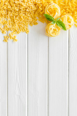 Italian pasta for restaurant on white wooden table background top view space for text