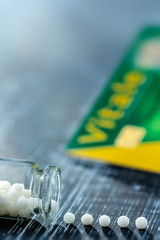 Concept of homeopathic pills and french health card, Reimbursement ort not.Still life