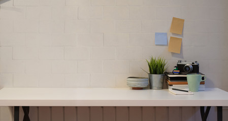 Minimal work place with white wall background
