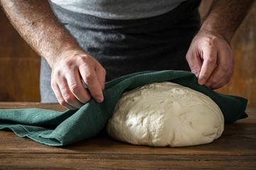 Wall Mural - Man cooked fresh dough baking homemade bread
