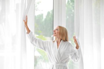 Wall Mural - Morning of beautiful young woman near window