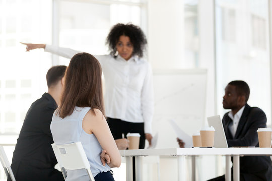 African American angry boss point at door, ask employee leave