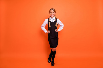 Full length body size view of her she nice attractive lovely cheerful cheery content pre-teen girl enjoying going first grade 1 September isolated on bright vivid shine orange background Wall mural