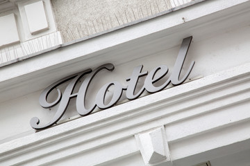 Silver Hotel Sign on Building