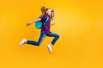 Full size profile photo of little pupil jump high holidays wear casual checkered shirt jeans denim isolated yellow background