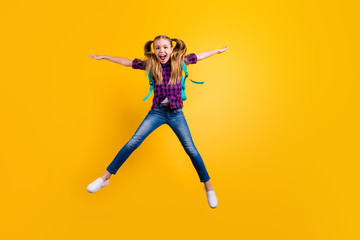 Full body photo of little pupil jump high star shape holidays wear casual checkered shirt jeans denim isolated yellow background