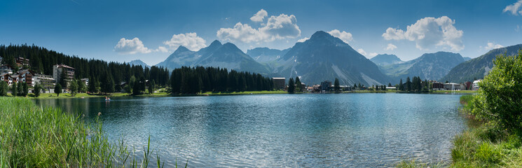 panorama landscape view of the lake and town of Arosa in the Swiss Alps