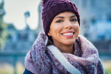 Happy african woman in winter