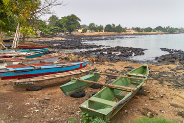 The colourful wooden Fishing Canoes of this Fishing Village in Sao Tome lie on the beach at dawn, ready for use as the light of the day gets up.