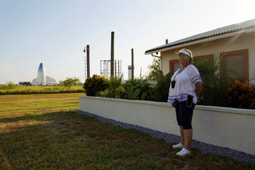 Maria Pointer poses for a photo outside her house adjacent to SpaceX facilities in Boca Chica