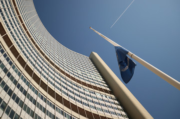 A flag with the logo of the International Atomic Energy Agency (IAEA) flies at half-mast at the United Nations headquarters in Vienna