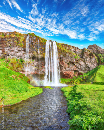Wall mural Fantastic Seljalandsfoss waterfall in Iceland during sunny day.