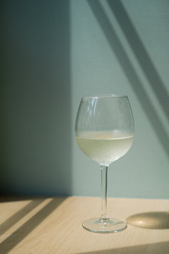 Glass of white wine on a table