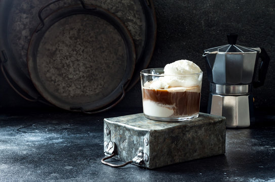 Affogato coffee with vanilla ice cream. Summer coffee drink with ice cream and espresso in the glass