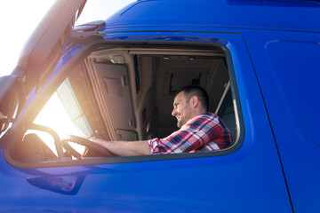 Truck driver occupation. Caucasian middle aged trucker driving long vehicle. Transportation services. Fototapete