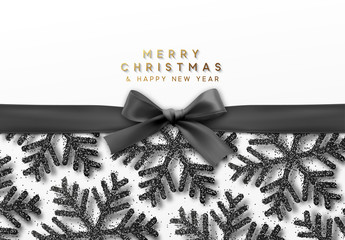 Christmas background with shining black snowflakes and a dark ribbon with bow