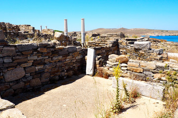 view of an ancient trade in the archaeological city of Delos Island, near Mykonos, beautiful Cycladic island, in the heart of the Aegean Sea