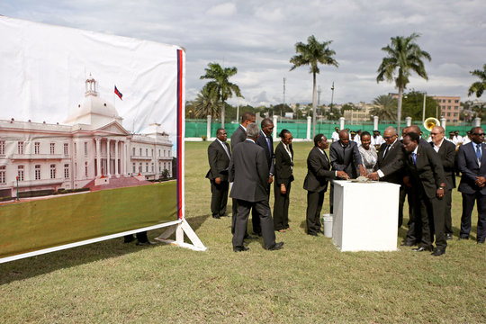 Haiti's President Moise lays the first brick for the reconstruction of the presidential palace after it was destroyed in an earthquake, during the eighth anniversary of the earthquake, in Port-au-Prince