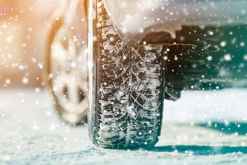 Close-up of car wheels rubber tires in deep winter snow. Transportation and safety concept. Fototapete