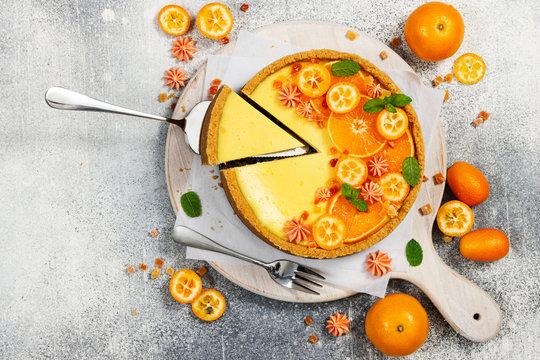 Cheesecake with slices of orange and kumquat