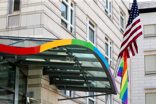 The LGBT pride flag is pictured next to the U.S. flag outside the U.S. embassy ahead of the the Gay Pride parade, also called Christopher Street Day parade (CSD) in Berlin