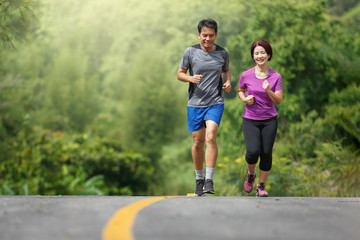 Asian middle aged couple  jogging exercise in park