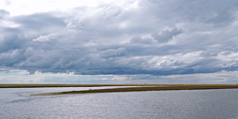 Laesoe / Denmark: View over the shallow water to a flat and wide salt marsh island in the south of the Kattegat island