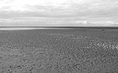 Laesoe / Denmark: Wide mudflat area with some smaller erratic boulders between Kringelroen and Hornfiskroen in the south of the Kattegat island