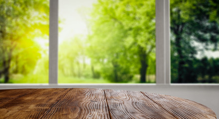 Desk of free space and summer window background