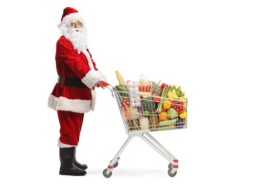 Santa Claus with a shopping cart full of food products