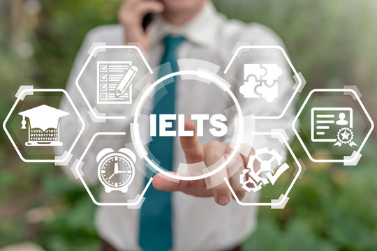 Man touches ielts acronym on virtual screen. IELTS International English Language Testing System. English test exam education concept.