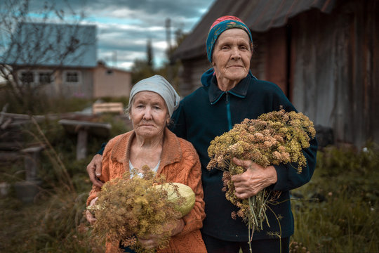 Portrait of senior women with dill herbs standing outdoors