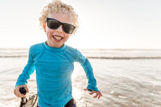 Smiling boy on beach